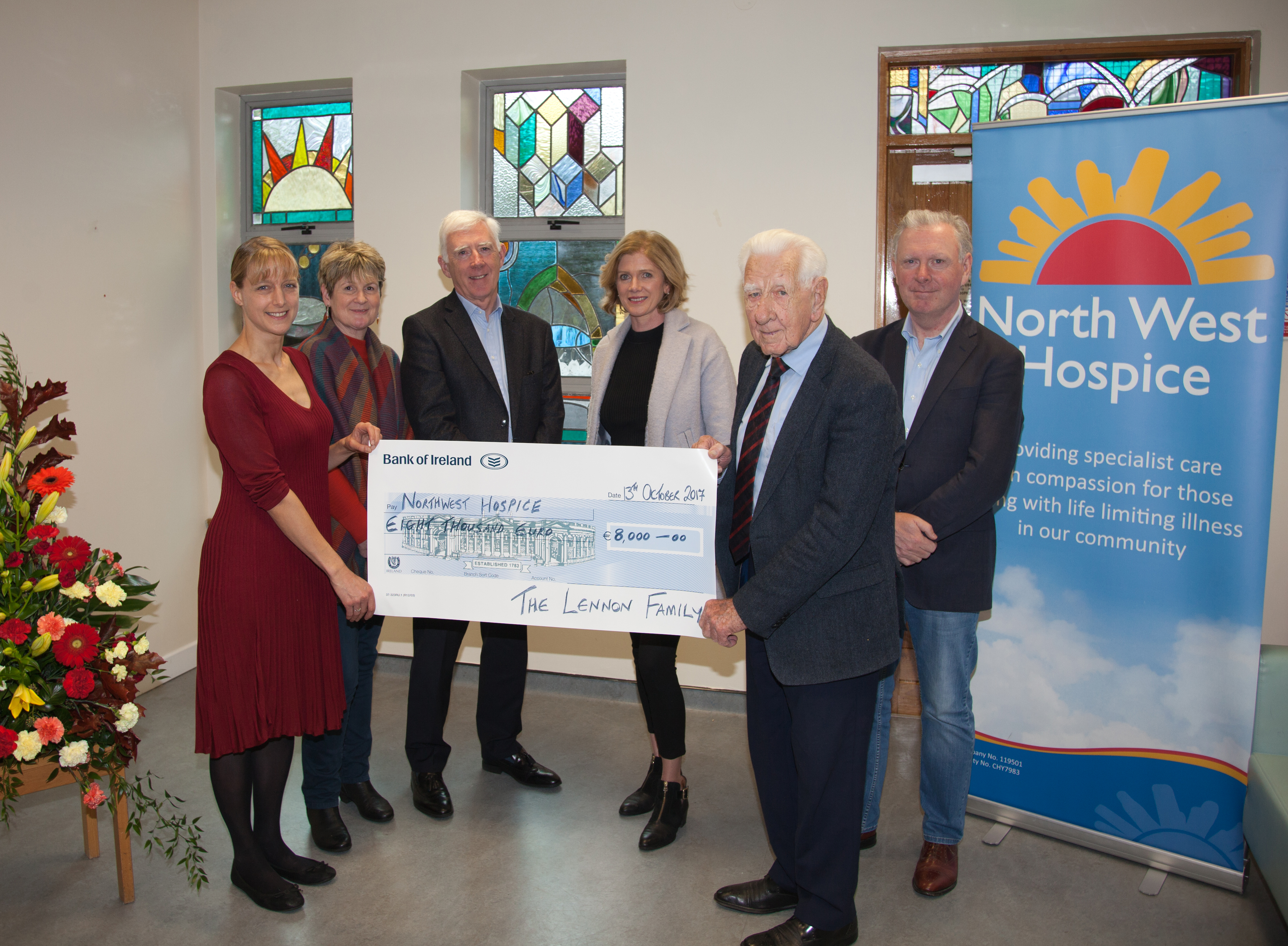 Ben Lennon presenting a cheque to North West Hospice