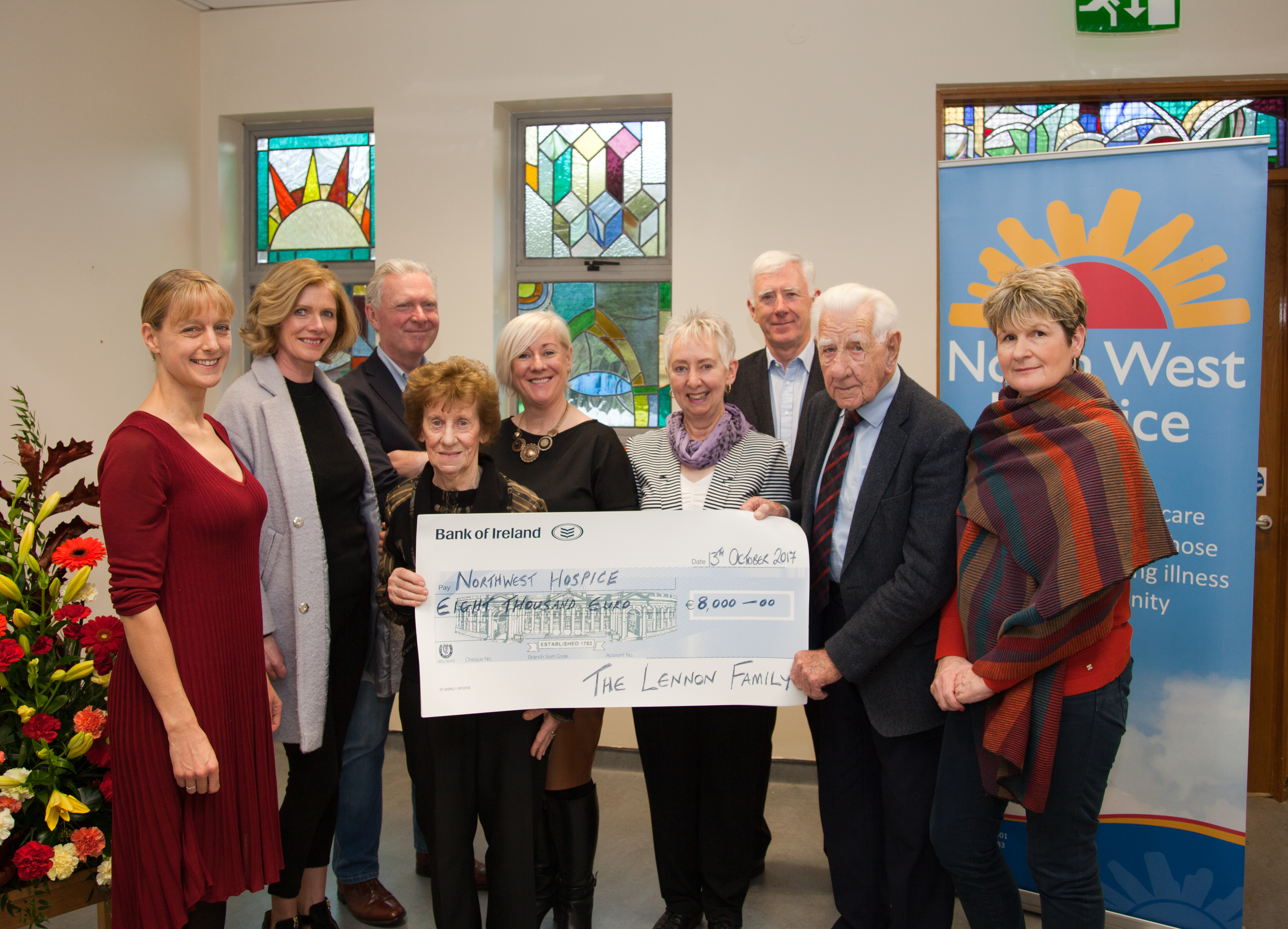 Lennon family presenting a cheque to North West Hospice