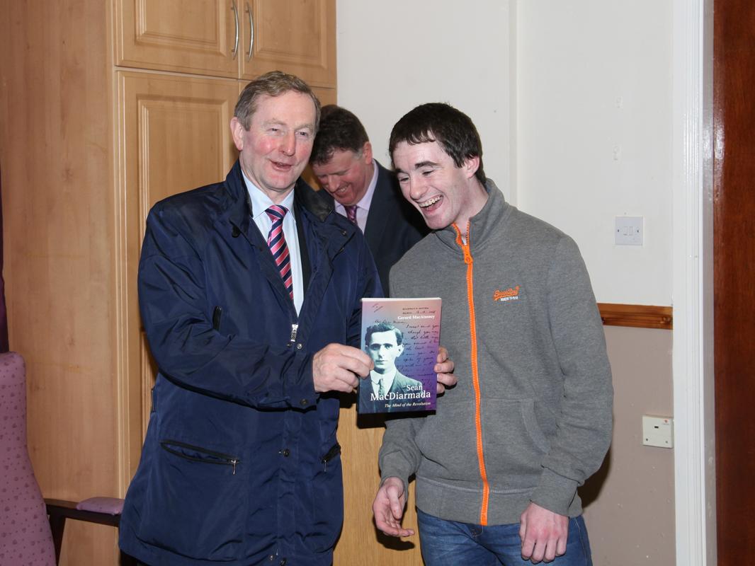 An Taoiseach receiving Gerard MacAtasney's book Sean MacDiarmada from Oisin Keaney